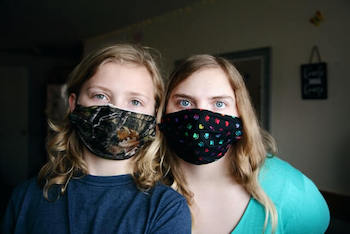 Golden Retriever Face Masks - Woman and child shown wearing printed cloth face masks.